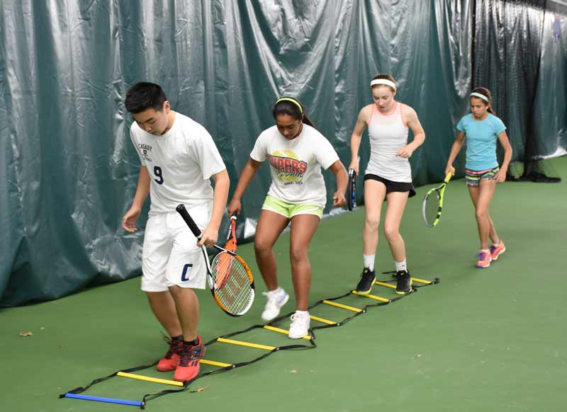 Youth work through at ladder drill at the OKC Tennis Center