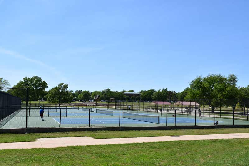 OKC residents enjoy an afternoon of tennis at Memorial Park