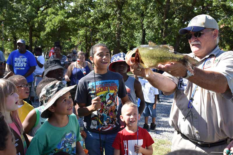 Children enjoy free summer fishing lessons