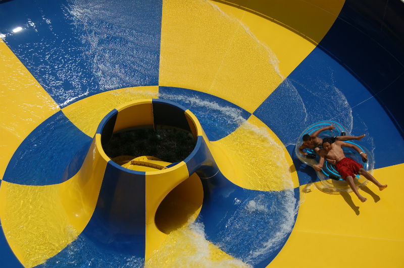 Swimmers enjoy the bowl slide at Earlywine Family Aquatic Center