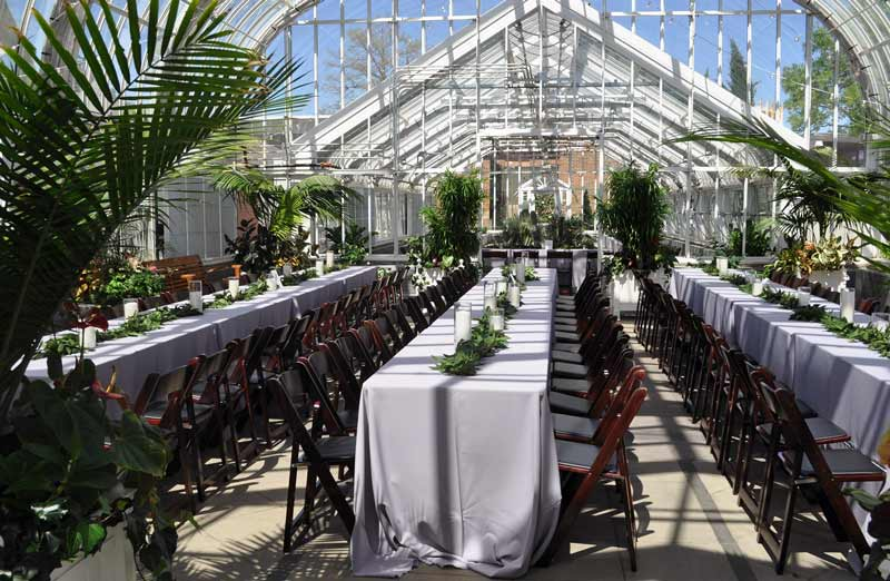 A reception banquet set-up inside the Ed Lycan Conservatory