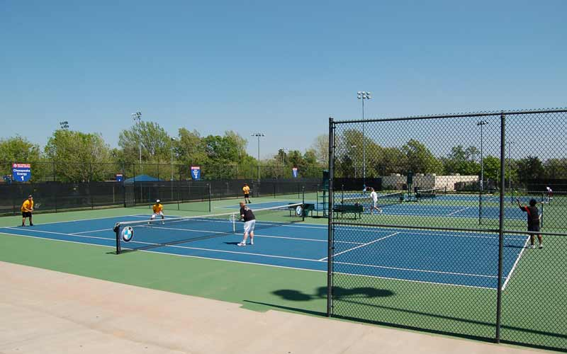 Tennis players enjoy the outdoor courts at the OKC Tennis Center