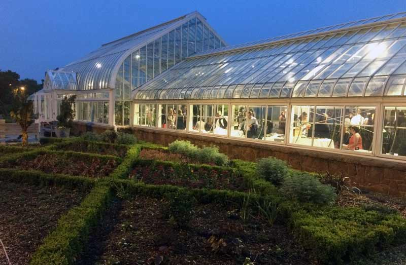 The Ed Lycan Conservatory lights up at night for a beautiful event space