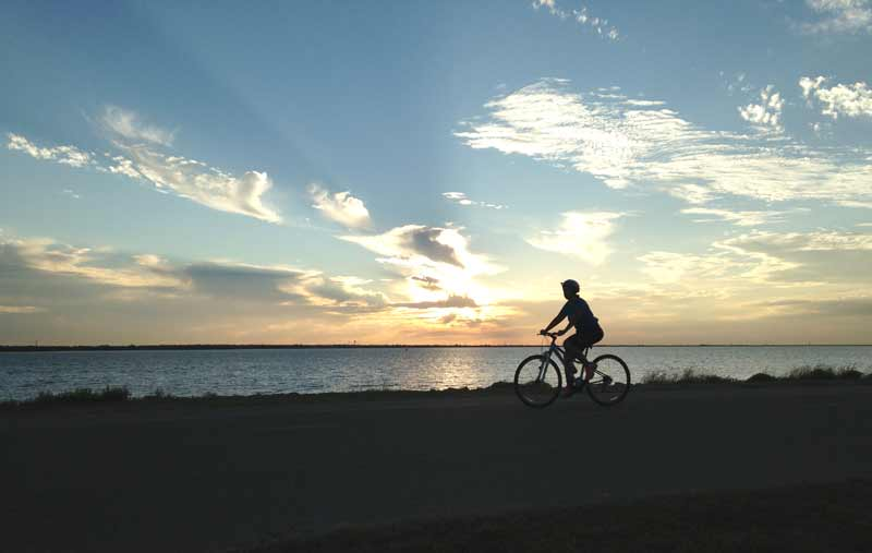 Residents enjoy the sunset views at Lake Hefner on the Burt Cooper Trails