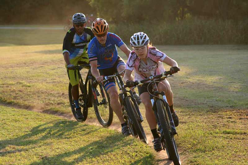 Riders push through the technical course at Bluff Creek Park