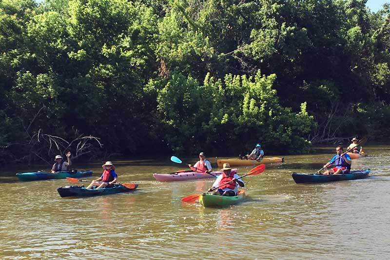 Kayakers enjoy a morning at the Stinchcomb Wildlife Refuge