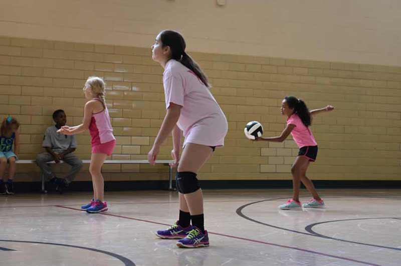 Boys and girls participate in our summer volleyball camp