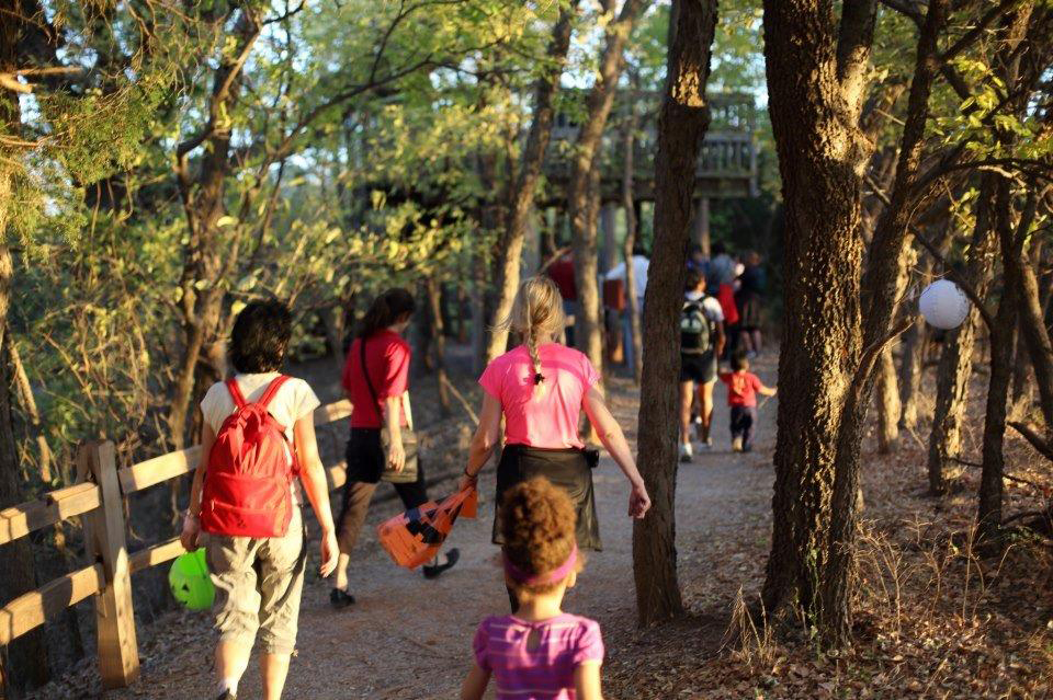 "Hikers take to the evening woods in search of treats during ""Haunted Hikes"""