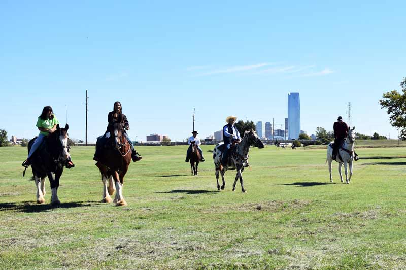 Horseback riders enjoy the downtown views of the equestrian area in River Park